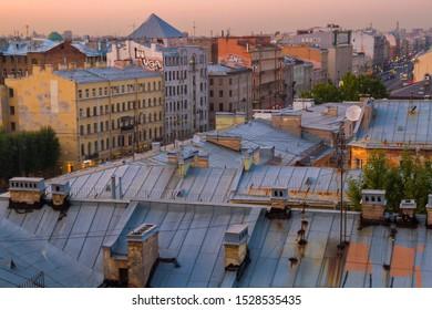 "Saint Petersburg, Russia - 09.09.2019: View of the historic part of city from the ""Loft progect Etagi"". Roofs of Petersburg, Ligovsky prospekt. Sunset sky."