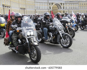 Saint Petersburg,  Russia - 13 August 2016:   People and motorcycles on the Palace Square. The annual parade of Harley Davidson. Arch of the General Staff in the Palace Square.