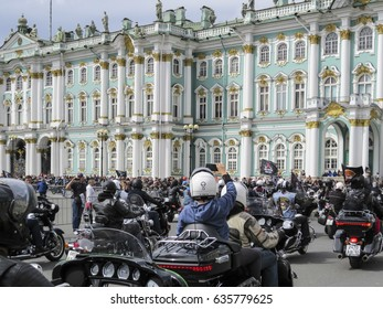 Saint Petersburg,  Russia - 13 August 2016:  People and motorcycles on the Palace Square. The annual parade of Harley Davidson. background Winter Palace, Hermitage Museum.