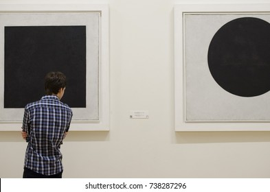 SAINT PETERSBURG, RUSSIA - 22 JULY, 2017: famous State Russian Museum (Mikhailovsky Palace), young man looks at the Kazimir Malevich works