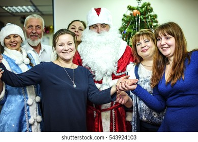 Saint Petersburg, Russia - 27 Dec 2016: New year greetings. Office staff congratulates Santa Claus and snow maiden. New year celebration in the company.