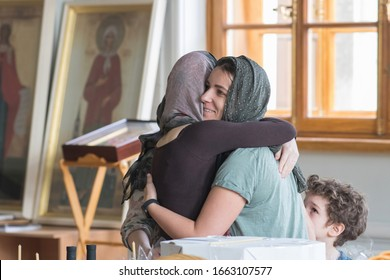 Saint Petersburg, Russia - 27th April, 2019: Religion in Russia. Hugs in the orthodox church during Easter service.