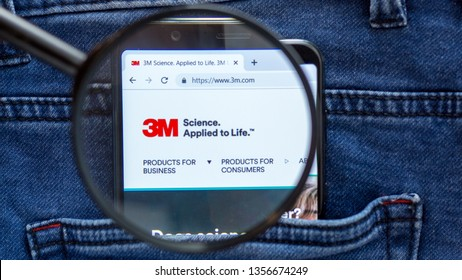 Saint Petersburg, RUSSIA - 29 March, 2019: 3M website homepage. 3M logo visible on on the smartphone display. Company name is approached through a magnifying glass
