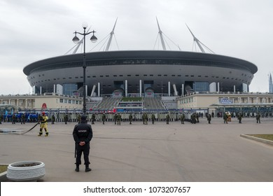 SAINT PETERSBURG, RUSSIA - APRIL 20, 2018: Russian services take part in a simulation of the riot at Krestovsky Stadium. Preparing for the upcoming FIFA World Cup 2018. Policeman near football arena.