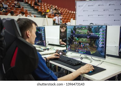 SAINT PETERSBURG, RUSSIA - APRIL 27, 2019: eSports competition, a team of gamers in computer games