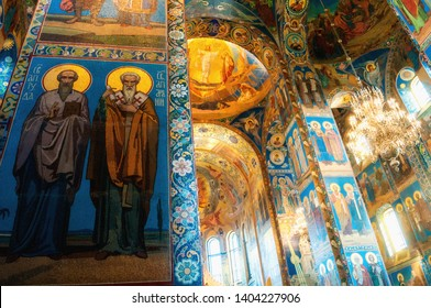 Saint Petersburg, Russia - April 5, 2019. Cathedral of Our Savior on Spilled blood - interior of St Petersburg landmark. Mosaics at the columns, Apostles Ananias and Jude at the foreground