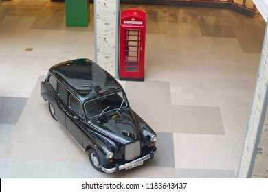 Saint Petersburg, Russia - August 10, 2018: London taxi Austin FX4 and a phone booth in the Mall as a decoration. The view from the top.