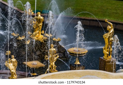 SAINT PETERSBURG, RUSSIA - AUGUST 12, 2018: Golden fountains in Petergof Grand Cascade, St. Petersburg, Russia