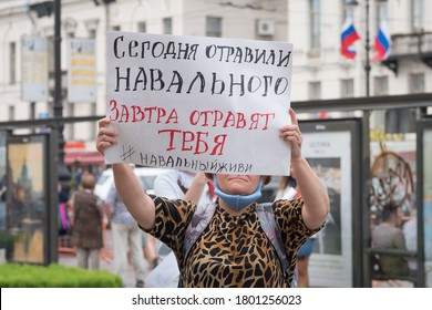 "Saint Petersburg, Russia - August 22, 2020: a protester holds a poster saying in Russian ""Today they poisoned Navalny, tomorrow they will poison you"" at a rally of solidarity near Gostiny Dvor Metro"