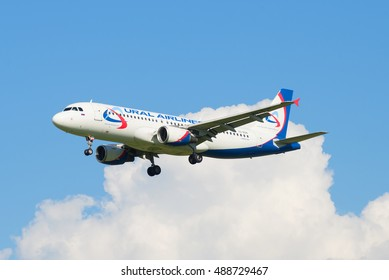 """SAINT PETERSBURG, RUSSIA - AUGUST 24, 2016: Airbus A320 (VQ-BQN) of airline """"Ural airlines"""" out of the clouds"""