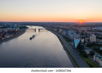Saint Petersburg. Russia. Bolsheokhtinsky bridge lifted. Bridge of Peter the Great at sunset. The drawbridges of Petersburg. Navigation on the Neva River. Cities of Russia. Panorama of St. Petersburg.