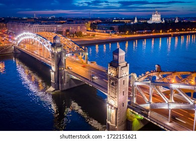 Saint Petersburg. Russia. Bolsheokhtinsky bridge in the evening. Smolny cathedral. Peter the Great bridge across the Neva. Bridges Of St. Petersburg. Panorama of evening St. Petersburg.