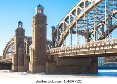 Saint Petersburg. Russia. Bridge of Peter the Great. Bolsheokhtinsky bridge on a winter day. Neva is covered with ice. Panorama of winter St. Petersburg. Traveling in winter Russia. Snow.