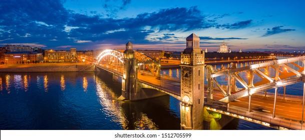 Saint Petersburg. Russia. Bridges across the Neva. Bolsheokhtinsky bridge. Panorama of St. Petersburg. The bridge of Emperor Peter the Great. Evening Petersburg. Guide to the cities of Russia.