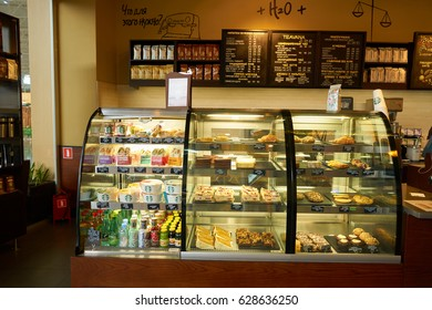 SAINT PETERSBURG, RUSSIA - CIRCA APRIL, 2017: food and desserts on display in Starbucks coffee shop. Starbucks Corporation is an American coffee company and coffeehouse chain.