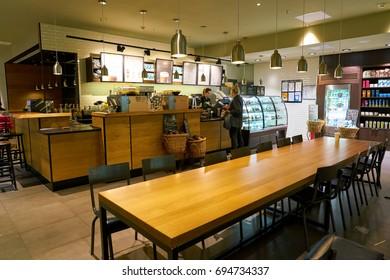 SAINT PETERSBURG, RUSSIA - CIRCA AUGUST, 2017: inside Starbucks coffee shop at Pulkovo airport. Starbucks Corporation is an American coffee company and coffeehouse chain.