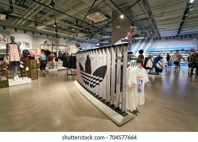 SAINT PETERSBURG, RUSSIA - CIRCA AUGUST, 2017: inside Adidas store. Adidas AG is a German multinational corporation, that designs and manufactures shoes, clothing and accessories.
