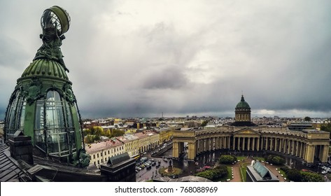Saint Petersburg, Russia - Circa June 2017: Bronze dome of building of the Company Zinger on Nevsky avenue and Kazan Cathedral or Cathedral of Our Lady of Kazan, Saint Petersburg, Russia