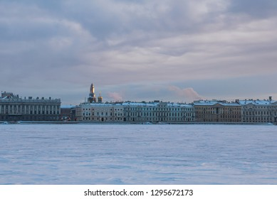 Saint Petersburg in Russia -city view: Frozen in extreme cold Neva River and Saviour on the Spilled Blood Church apex at sunset