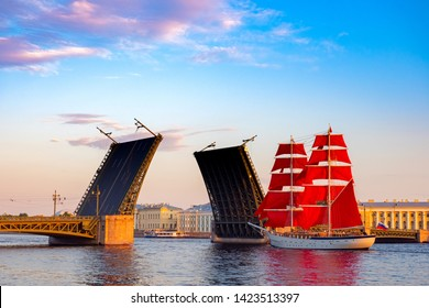 Saint Petersburg. Russia. Divorced bridge. Holiday Scarlet Sails. Sailboat passes under the Palace Bridge. Palace Embankment of St. Petersburg. White Nights. Divorce bridges. Russian Federation.