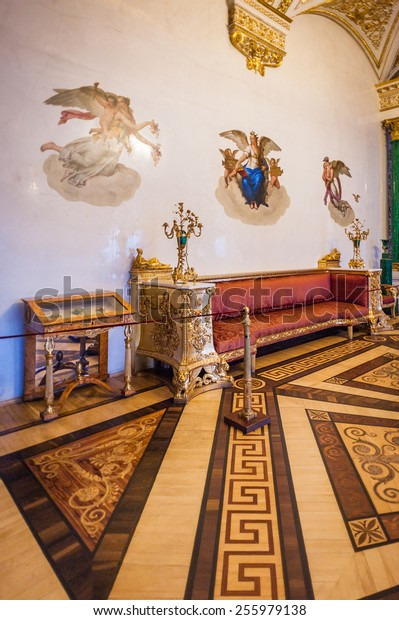 SAINT PETERSBURG, RUSSIA - FEB 24, 2015: Golden room in the State Hermitage, a museum of art and culture in Saint Petersburg, Russia. It was founded in 1764 by Catherine the Great
