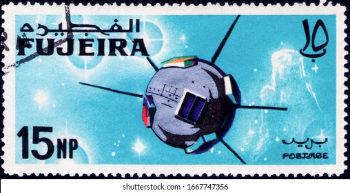 Saint Petersburg, Russia - February 06, 2020: Postage stamp issued in the Fujairah with the image of the Geodetic satellite Vanguard 1, USA, circa 1966