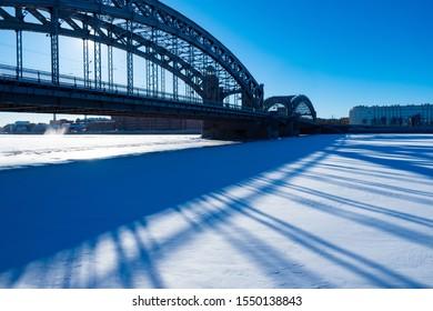 Saint Petersburg. Russia. Fragment of Bridge of Peter the Great. Bolsheokhtinsky bridge close-up. Shadow. Tour of the bridges of St. Petersburg. Winter Petersburg. Traveling to the cities of Russia