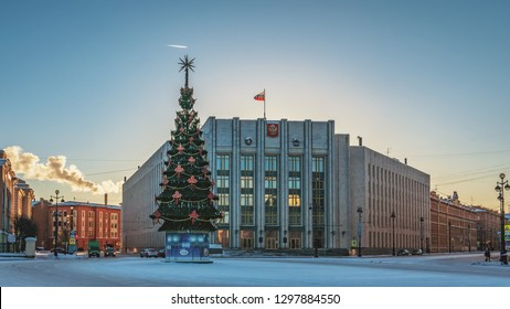 SAINT PETERSBURG, RUSSIA - JANUARY 12 , 2018 : County govermental office building`at 67 Suvorovskiy Prospekt in winter with a Christmas tree in the front of the facade at sunset