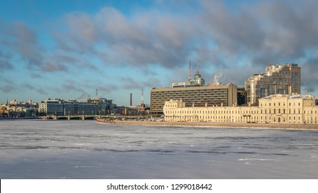 SAINT PETERSBURG, RUSSIA - JANUARY 12 , 2018 : Frozen in extreme cold Neva River , Pirogovskaya Embankment Hotel Saint Petersburg and adjancent buildings in a daylight