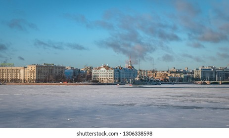 SAINT PETERSBURG, RUSSIA - JANUARY 12 , 2018 : Frozen Neva River , Nakhimov Naval School and  Cruiser Aurora on a sunny winter day
