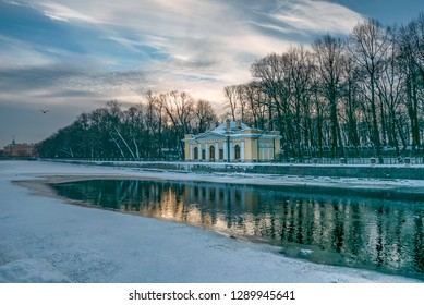 SAINT PETERSBURG, RUSSIA - JANUARY 13 , 2018 : Frozen Fontanka River, Summer Gardens and the Tea House of Peter The Great at sunset
