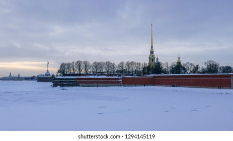 SAINT PETERSBURG, RUSSIA - JANUARY 13 , 2018 : Frozen in extreme cold Neva River and Peter and Paul Fortress at sunset - panoramic