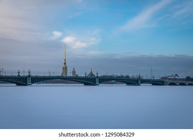 SAINT PETERSBURG, RUSSIA - JANUARY 13 , 2018 : Frozen in extreme cold Neva River , Troitsky bridge and Peter and Paul Fortress  at sunset