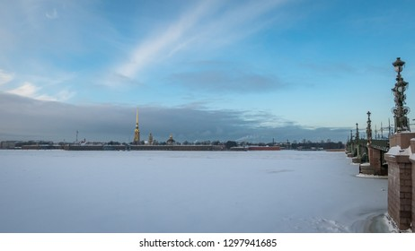 SAINT PETERSBURG, RUSSIA - JANUARY 13 , 2018 : Frozen in extreme cold Neva River, Troitskiy Bridge  and Peter and Paul Fortress at sunset