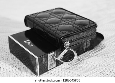 Saint Petersburg, Russia - January 14, 2019: Dior brush set - box, cosmetic bag and Dior logo. Dior is a French luxury goods company. Illustrative editorial image on interior background - Image