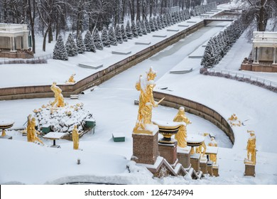 SAINT PETERSBURG, RUSSIA - JANUARY 22, 2018: Peterhof in winter. Statues Of the Grand cascade and Samson tearing the lion's mouth covered with snow