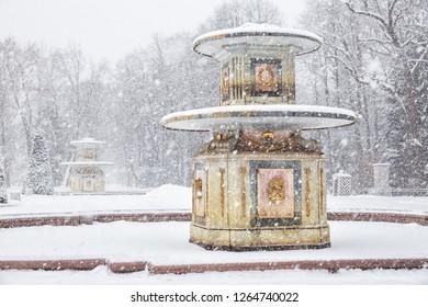 SAINT PETERSBURG, RUSSIA - JANUARY 22, 2018: Peterhof in winter. Roman fountains in the Lower Park of Peterhof in heavy snowfall