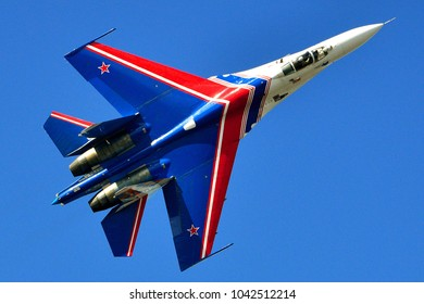 Saint Petersburg, Russia, July 02, 2015: Russian Su-27 (Flanker-B) from aerobatic team Russians Knights shows demonstration flight at port area in St. Petersburg.