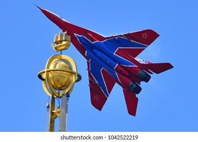 Saint Petersburg, Russia, July 02, 2015: Russian MIG-29 (FULCRUM) from aerobatic team STRIZHI over the symbol of St. Petersburg close-up.
