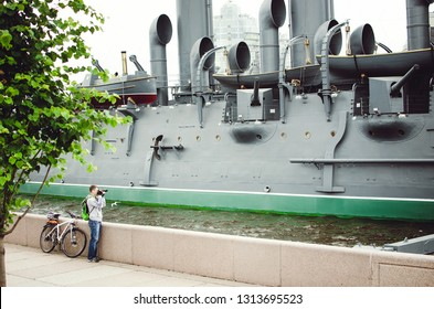 Saint Petersburg, RUSSIA - July 08, 2018: Aurora in St. Petersburg. Tourist photographs the famous ship.