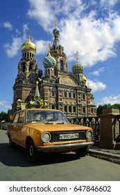 SAINT PETERSBURG, RUSSIA - JULY 1: Iconic Lada vehicle parked outside The Church of the Savior on Spilled Blood  on July 1, 2006 in Saint Peterburg, Russia