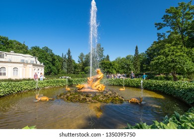 SAINT- PETERSBURG, RUSSIA - JULY 10, 2017: The Triton fountain in the Lower Garden of Peterhof, Saint-Petersburg, Russia. The park ensemble of Peterhof belongs to the world heritage of UNESCO