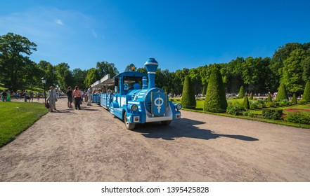 SAINT- PETERSBURG, RUSSIA - JULY 10, 2017: The touristic train in the Lower Garden of Peterhof, Saint-Petersburg, Russia. The park ensemble of Peterhof belongs to the world heritage of UNESCO