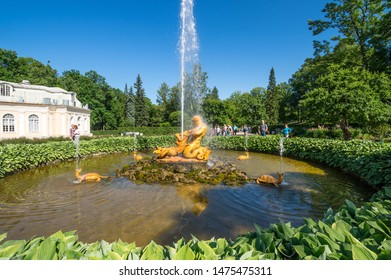 SAINT- PETERSBURG, RUSSIA - JULY 10, 2017: The Triton fountain in the Lower Garden of Peterhof, Saint-Petersburg, Russia. The park ensemble of Peterhof belongs to the world heritage of UNESCO
