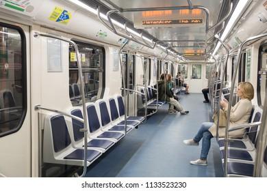 SAINT PETERSBURG, RUSSIA - JULY 11, 2018: People go in a new half-empty subway metro car
