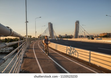 SAINT PETERSBURG, RUSSIA - JULY 11, 2018: unidentified cyclist rides on the Betancourt Bridge