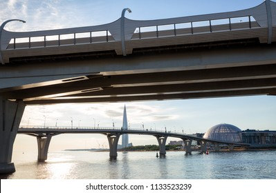 SAINT PETERSBURG, RUSSIA - JULY 11, 2018: Western high-speed diameter, pedestrian Yacht Bridge, Lakhta Center Tower and a glass dome of the shopping and entertainment complex Piterland