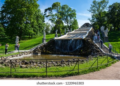 SAINT- PETERSBURG, RUSSIA - JULY 11, 2016: The Chess Mountain Cascade  in the Lower Garden of Peterhof, Saint-Petersburg, Russia. The park ensemble of Peterhof belongs to the world heritage of UNESCO