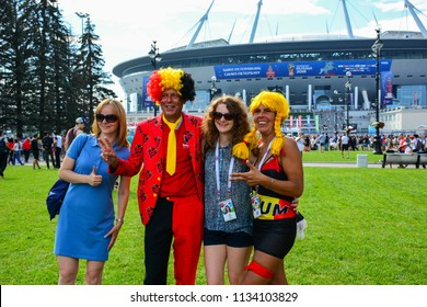 Saint Petersburg / Russia — July 14, 2018: Belgian and Russian football fans and supporters take pictures at Saint Petersburg Stadium before the 3rd Place Match of FIFA World Cup 2018