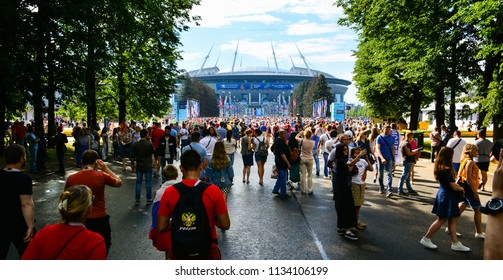 Saint Petersburg / Russia — July 14, 2018: football fans arrive at Saint Petersburg Stadium (Krestovsky Stadium) for the 3rd Place Match of FIFA World Cup 2018